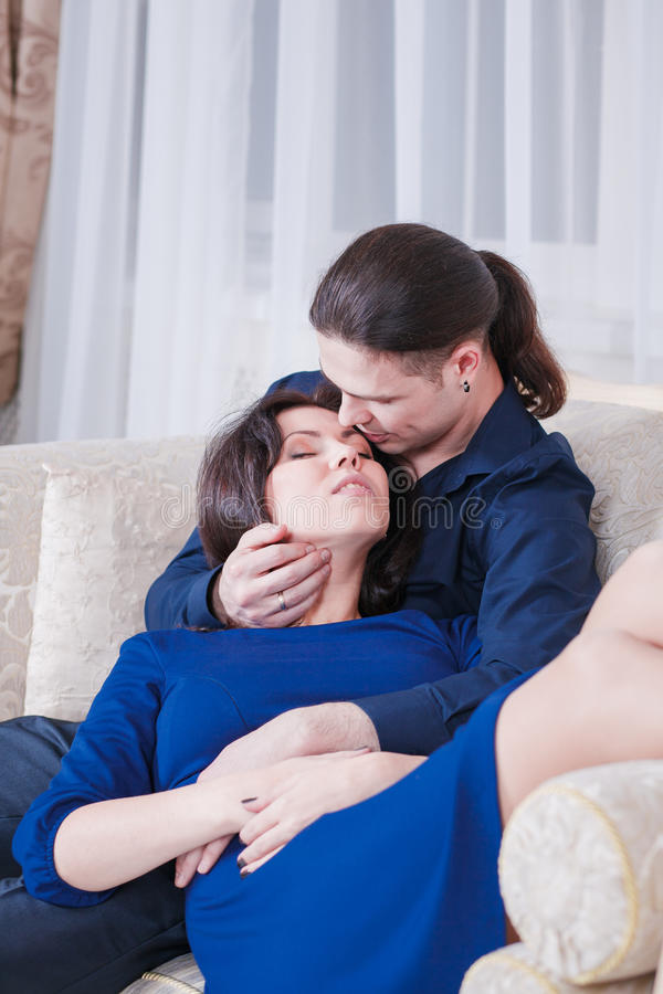Kramar gravida par arkivbild