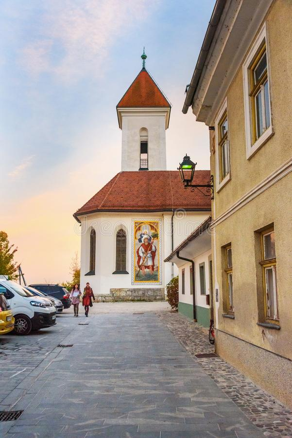 St. Roch`s and St. Fabian Church in old town Kranj in Slovenia. Kranj, Slovenia - October 25, 2018: St. Roch`s and St. Fabian Church in old town Kranj stock photos
