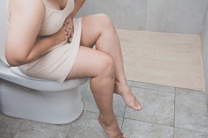 Kranke fette Frau stockfotografie