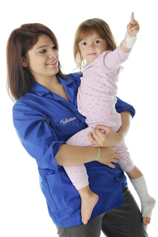 Krankenhaus Voluteer mit Kind lizenzfreie stockfotografie