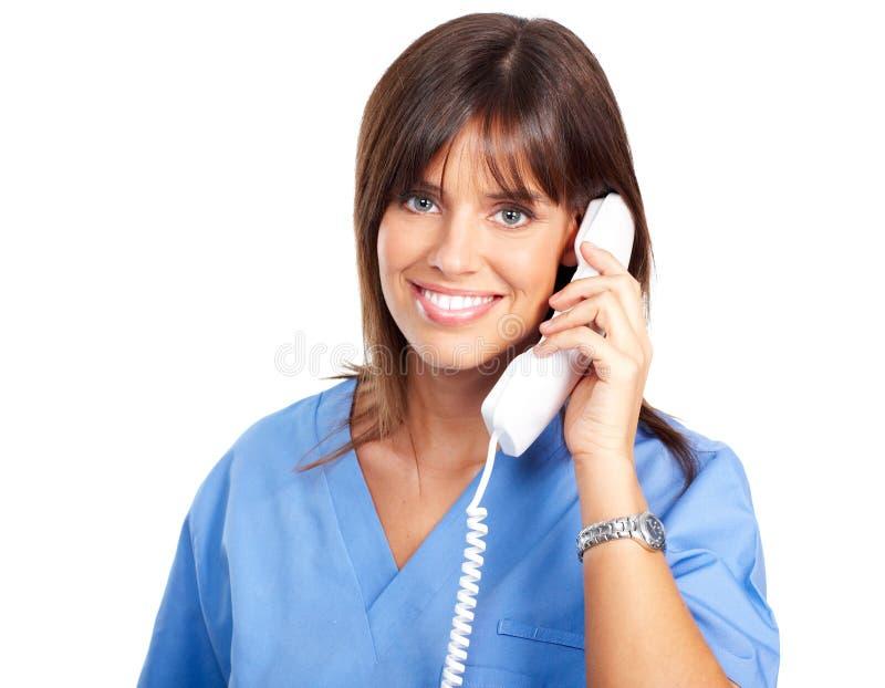 Krankenschwester mit Telefon lizenzfreie stockfotos