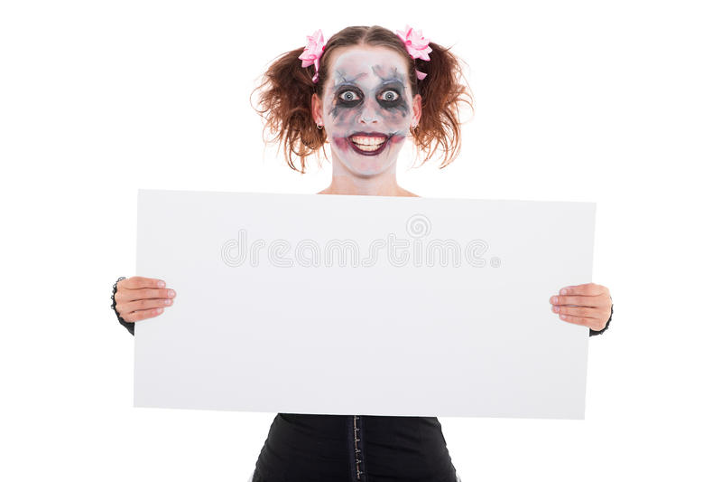 Krankzinnige glimlachende vrouwelijke clown met teken stock foto