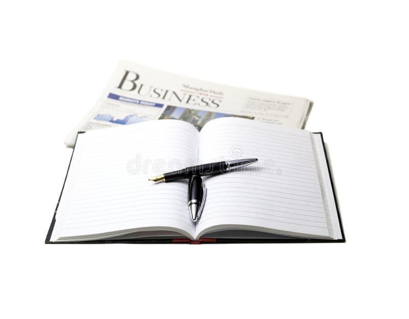 Krant, pen en notitieboekje royalty-vrije stock afbeelding