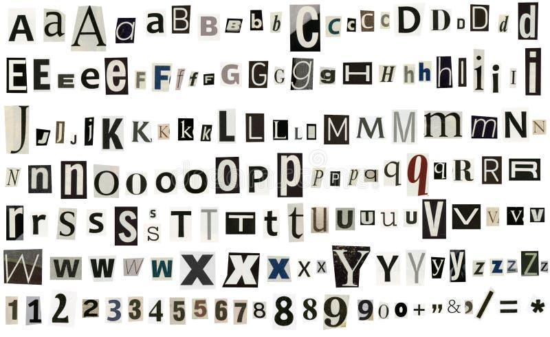 Krant, tijdschriftalfabet met aantallen en symbolen stock foto