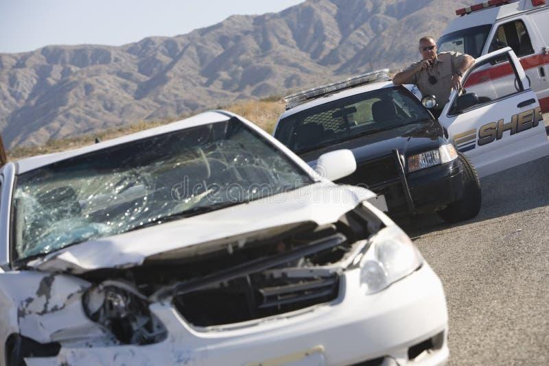 Krasch för polisAt Scene Of bil royaltyfria bilder