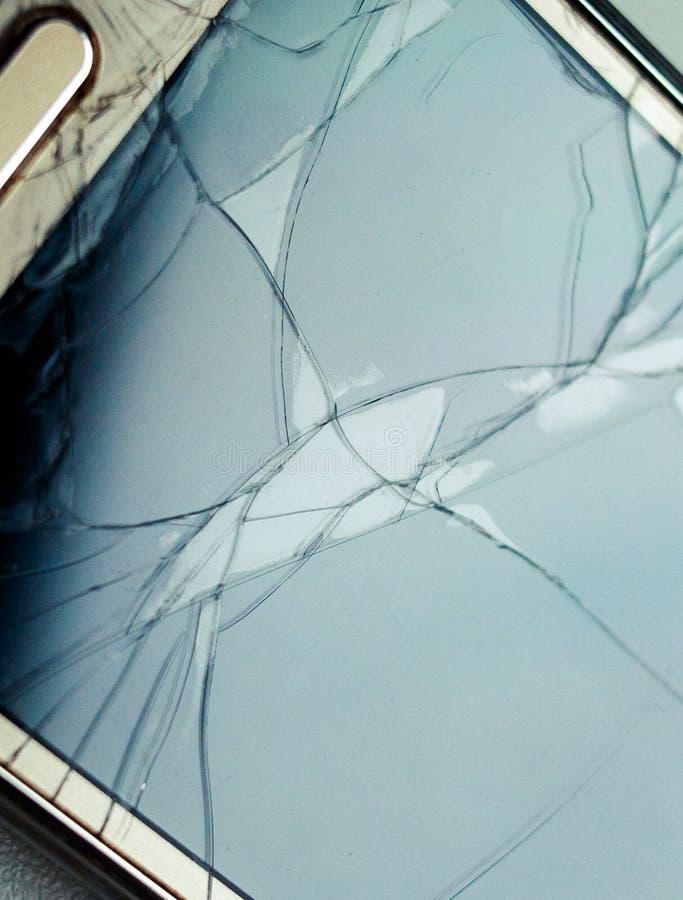 Kraschat exponeringsglas av en telefonskärm fotografering för bildbyråer