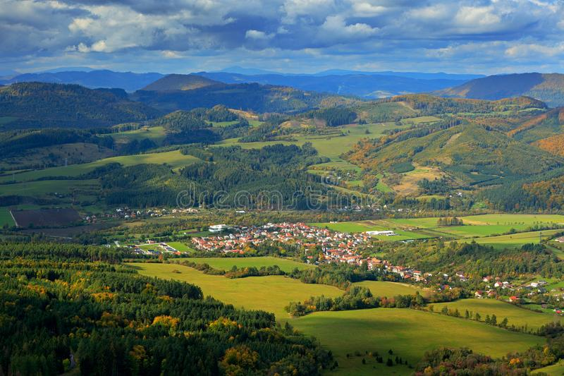 Krasnany town from Mala Fatra mountain. FView of the evening village from the mountains in Slovakia. Mountain forest with storm cl stock photos