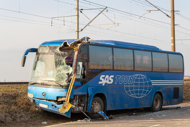 KRASNODAR REGION, RUSSIA - MARCH 28, 2018: The interurban bus le. Ft on the railway embankment after a collision with the truck royalty free stock photography