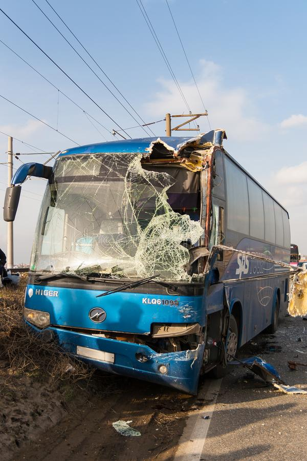 KRASNODAR REGION, RUSSIA - MARCH 28, 2018: The interurban bus le. Ft on the railway embankment after a collision with the truck royalty free stock image