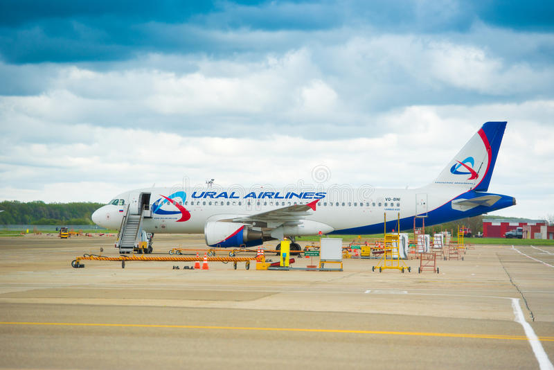 KRASNODAR, RUSSIA - APRIL 19, 2017: The plane of the Ural Airlines is preparing for the flight. Copy space. royalty free stock photo