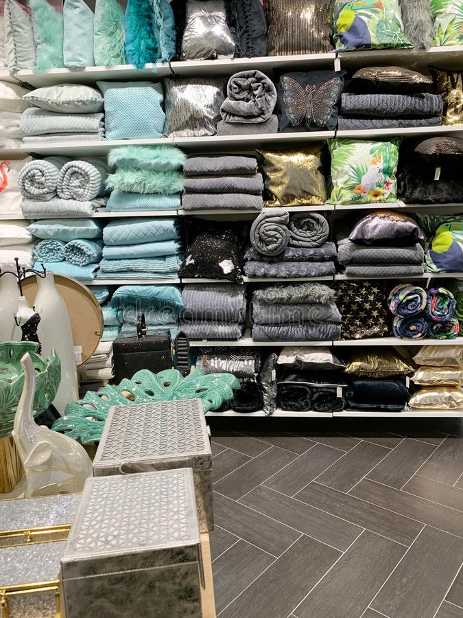Home Decorations In Decorations Store. Modern textile shop for towels and interior decor. stock photo