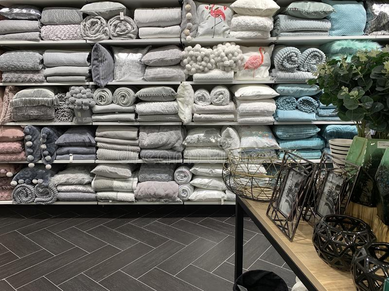 Home Decorations In Decorations Store. Modern textile shop for towels and interior decor. stock image