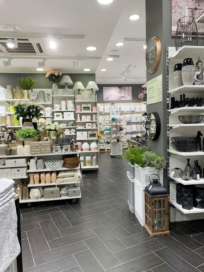 Home Decorations In Decorations Store. Modern textile shop for towels and interior decor. stock photos