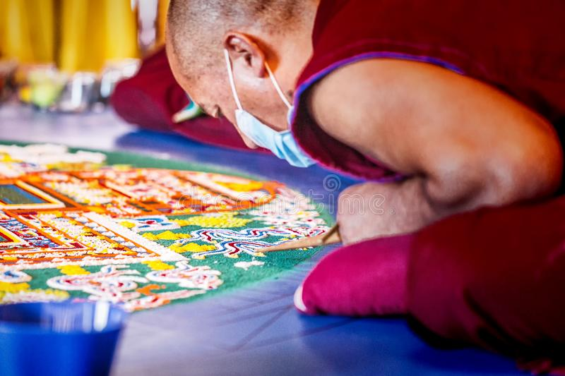 KRASNODAR, Russia - 22 May, 2014, Tibetan monk make mandala royalty free stock photo