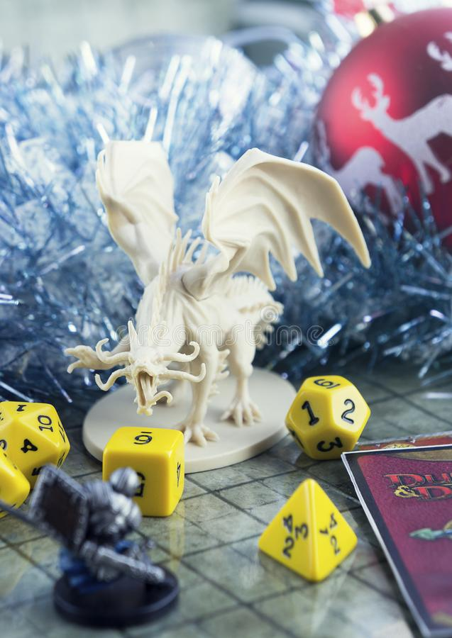 Krasnodar, Russia, 8 November 2018: Playing Dungeons and Dragons. Dices, plastic figure of white dragon and rpg characters. Christ. Mas New Year decorations royalty free stock images