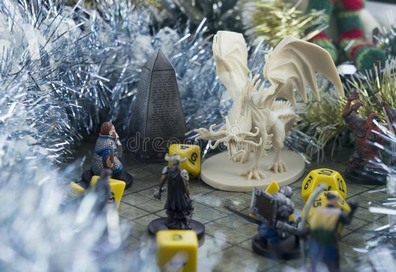 Krasnodar, Russia, 8 November 2018: Playing Dungeons and Dragons. Dices, plastic figure of white dragon and rpg characters. Christ. Mas New Year decorations stock photo