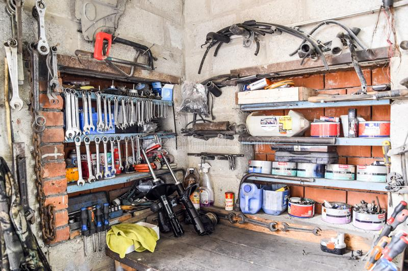 Wrenches and other tools in the car garage. royalty free stock photo