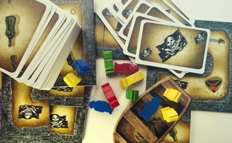 KRASNODAR/RUSSIAN FEDERATION – JUNE 28, 2017: Playing Cartagena board game, cards, wooden figures of pirates, boat. Hobby stock photos