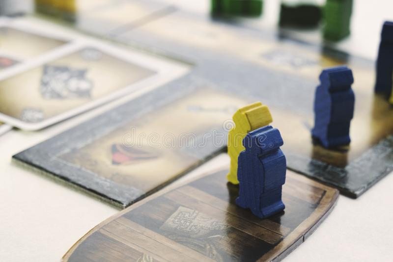 KRASNODAR/RUSSIAN FEDERATION – JUNE 28, 2017: Playing Cartagena board game, cards, wooden figures of pirates, boat. Hobby stock image