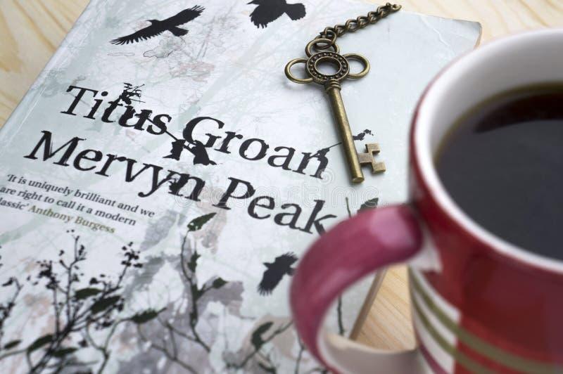 Krasnodar, Russian Federation, 21 November 2018: Reading book of famous British writer Mervyn Peake `Titus Groan` from Gormenghast. Trilogy. Book cover stock image