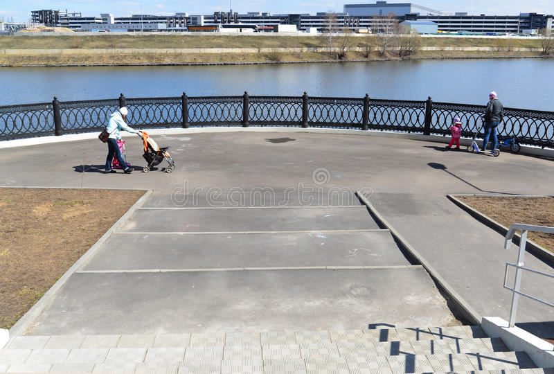 Krasnogorsk RUSSIA - 15.05.2015. The picturesque embankment on the Moscow River - place of mass walks in Moscow suburbs. Krasnogorsk RUSSIA - 15.05.2015. The stock photo
