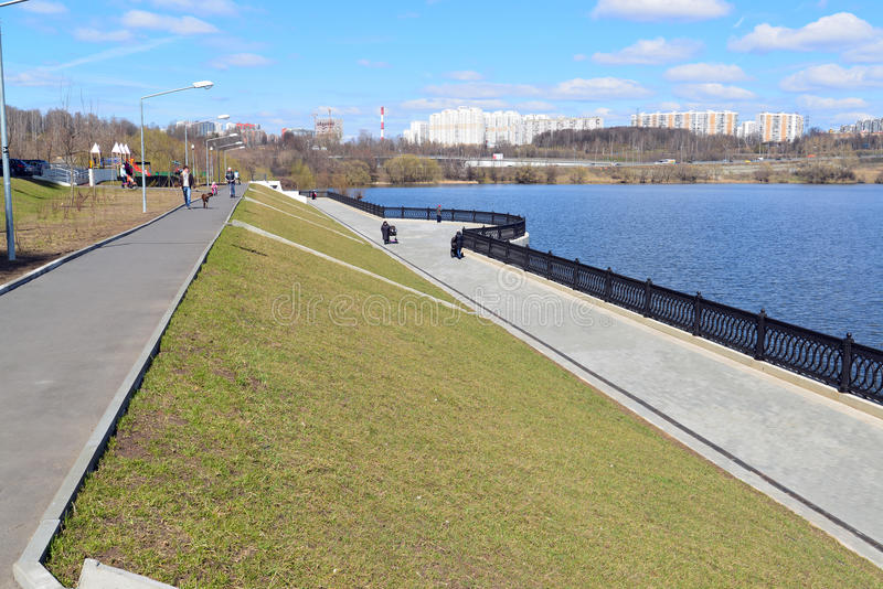 Krasnogorsk RUSSIA - 15.05.2015. The picturesque embankment on the Moscow River - place of mass walks in Moscow suburbs. Krasnogorsk RUSSIA - 15.05.2015. The stock image