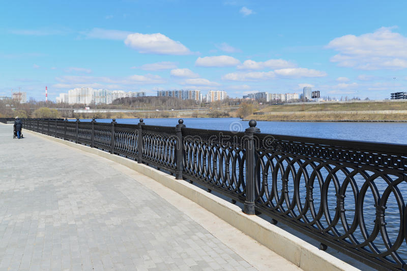 Krasnogorsk RUSSIA - 15.05.2015. The picturesque embankment on the Moscow River - place of mass walks in Moscow suburbs. Krasnogorsk RUSSIA - 15.05.2015. The royalty free stock image