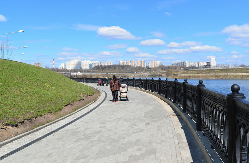 Krasnogorsk RUSSIA - 15.05.2015. The picturesque embankment on the Moscow River - place of mass walks in Moscow suburbs. Krasnogorsk RUSSIA - 15.05.2015. The royalty free stock images