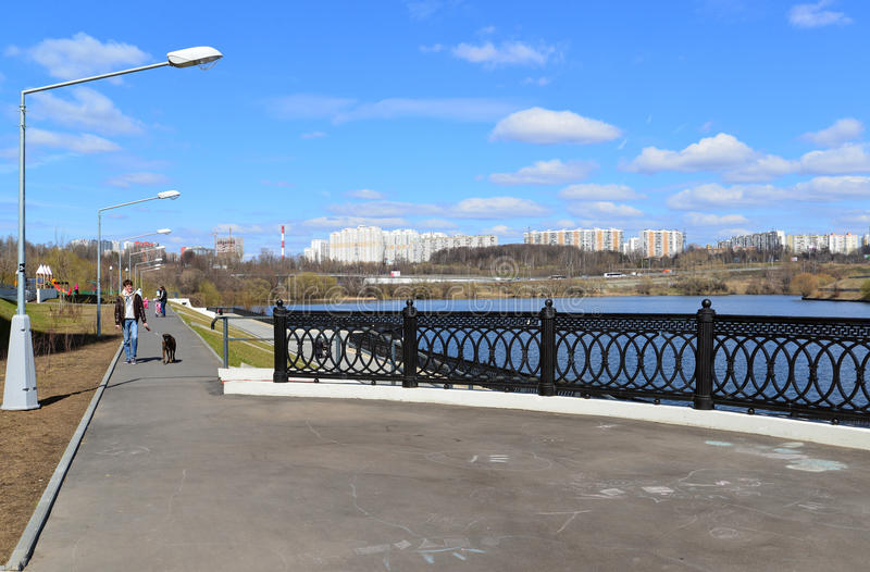 Krasnogorsk RUSSIA - 15.05.2015. The picturesque embankment on the Moscow River - place of mass walks in Moscow suburbs. Krasnogorsk RUSSIA - 15.05.2015. The royalty free stock photography