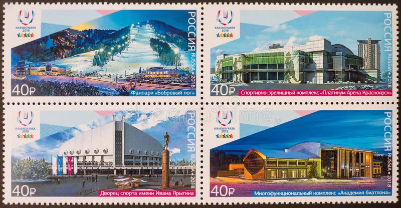 Krasnoyarsk, Россия 21-ое февраля 2019: Печать напечатанная в России показывает стадионы, зиму Universiade 2019 в Krasnoyarsk стоковое фото