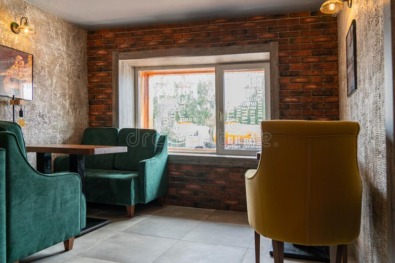 Krasnoyarsk, August 20, 2019: coffee shop DISCOVERY interior and decoration: tables, chairs, lounge areas in the loft. Style bar royalty free stock photo