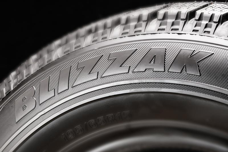 Krasnoyarsk, Russia, 20 august 2019: Blizzak - Japanese tire brand, Bridgestone company. Winter tire line. Logo on the. Side of the wheel closeup royalty free stock images
