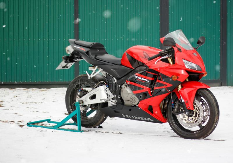 KRASNOYARSK, RUSSIA - March 18, 2019: Red and black sportbike Honda CBR 600 RR 2005 PC37 in winter. The bike is on the snow stock images