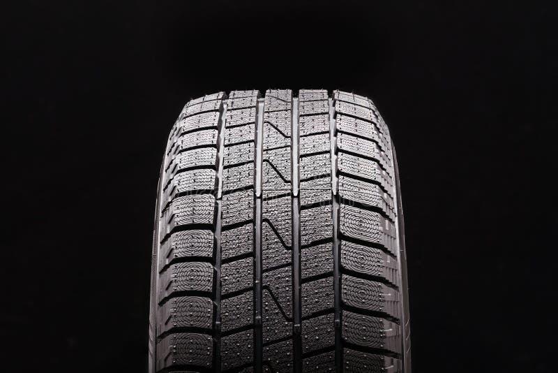Krasnoyarsk, Russia, 23 October 2019: Laufen LW 51 FITIZ logo tire brand. winter friction tires closeup. front view royalty free stock photos