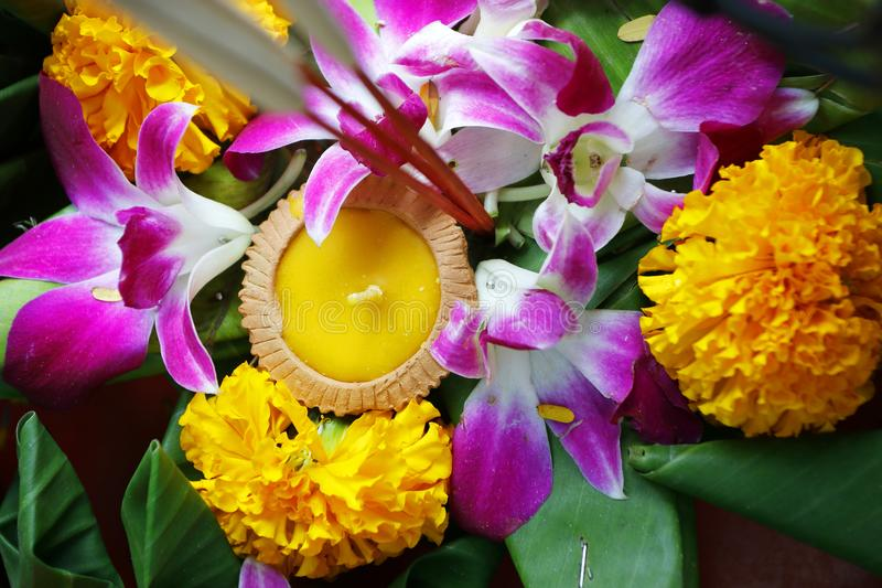 Krathong ,hand crafted floating basket by banana leaf,decorated with flowers and incense sticks, candle,. Light and float on water to celebrate festival Loy royalty free stock image