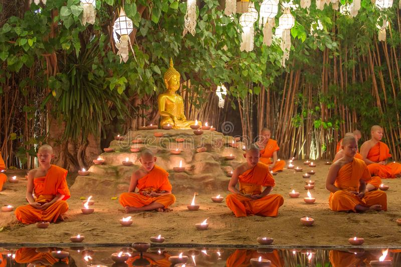 Kratong Festival, Buddhist monk fire candles to the Buddha and floating lamp on in Phan Tao Temple. Chiang Mai, Thailand - November 14, 2016: Loy Kratong stock photos