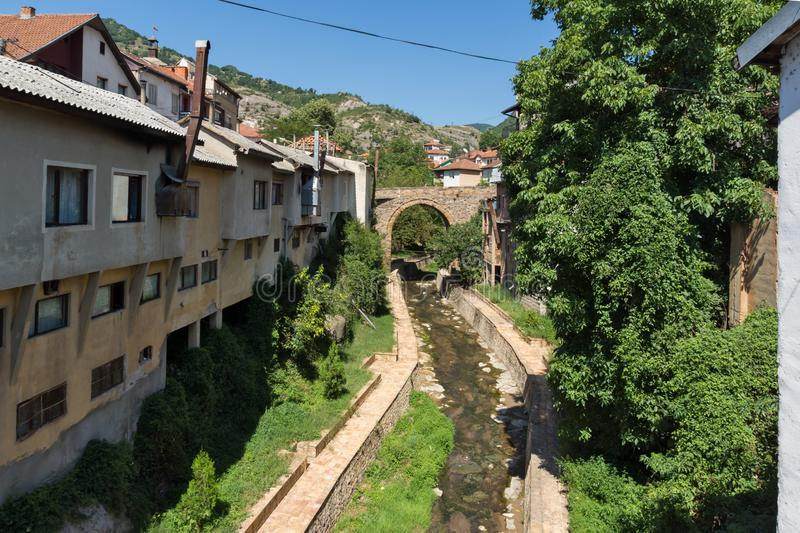 Old Medieval Bridge at the center of town of Kratovo, Republic of Macedonia. KRATOVO, MACEDONIA - JULY 21, 2018: Old Medieval Bridge at the center of town of royalty free stock photography