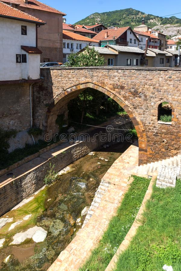 Old Medieval Bridge at the center of town of Kratovo, Republic of Macedonia. KRATOVO, MACEDONIA - JULY 21, 2018: Old Medieval Bridge at the center of town of stock image