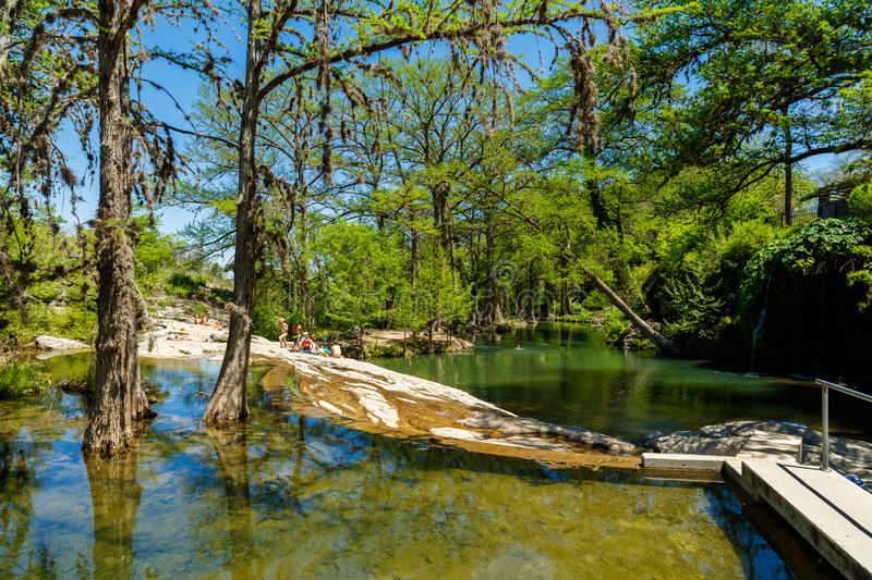 Krause Springs. Spicewood, Texas USA - April 5, 2016: Krause Springs is a popular tourist destination with camping and swimming activities in the Texas Hill royalty free stock images