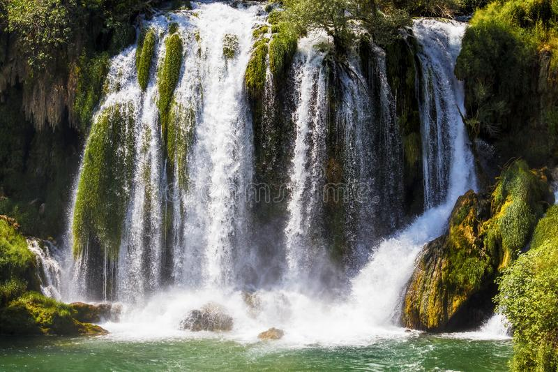Kravice waterfall on the Trebizat River in Bosnia and Herzegovina.  Miracle of Nature in Bosnia and Herzegovina. The Kravice. Waterfalls, originally known as stock photography