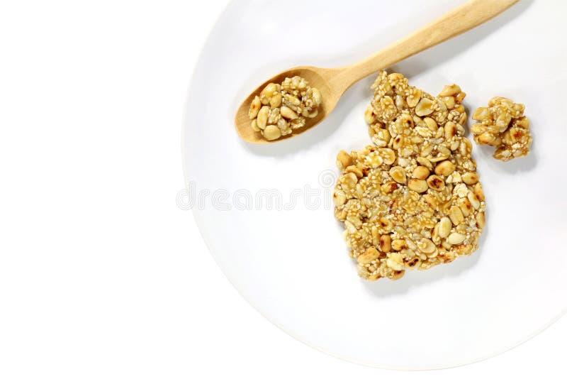 Krayasart, dessert dolce tailandese fatto di riso su fondo bianco d'annata, cereale, struttura dell'alimento, fatta di riso, dado immagine stock libera da diritti