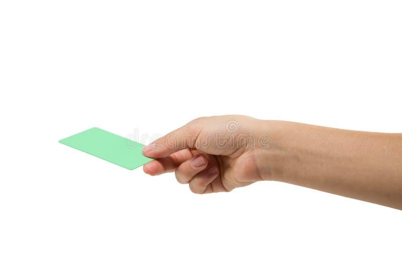 Kreditkort med handen arkivbild