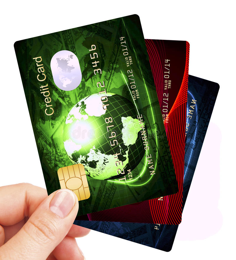 Kreditkortar luftar holded av handen över white royaltyfria bilder