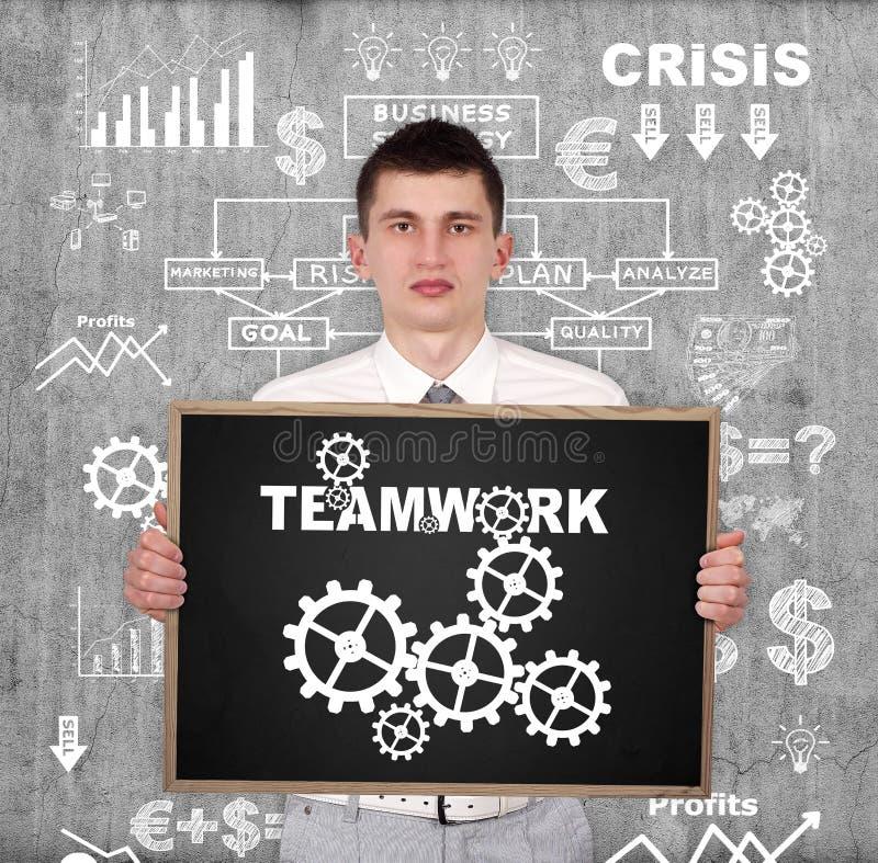 Kreidebrett mit Teamwork lizenzfreie abbildung