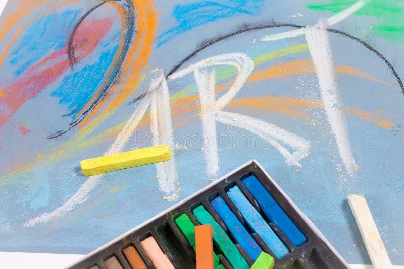 Kreidepastelle mit Wort Kunst stockbild