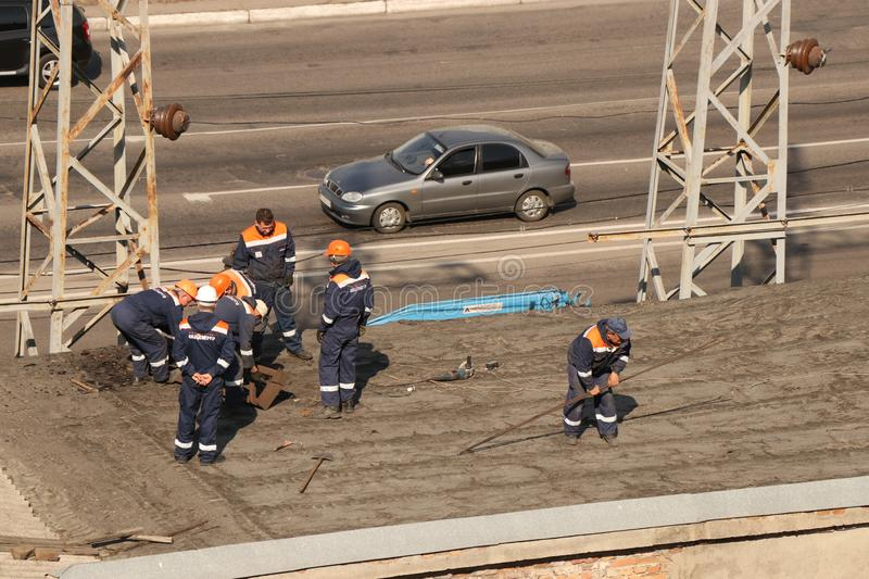 Kremenchug, Poltava region, Ukraine, April 9, 2019, repair of power grids on the roof of the building stock images