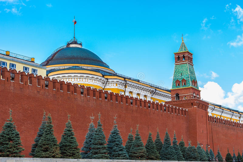 Kremlin Senate behind Kremlin Wall on red Square. In Moscow in Russia on sunny summer day stock photos