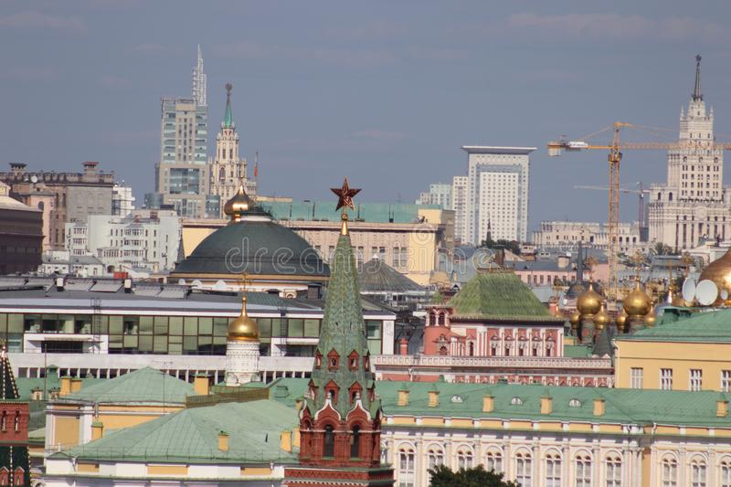 Kremlin tower with a star. Roofs of the Kremlin buildings. Temple domes, modern buildings. stock photo