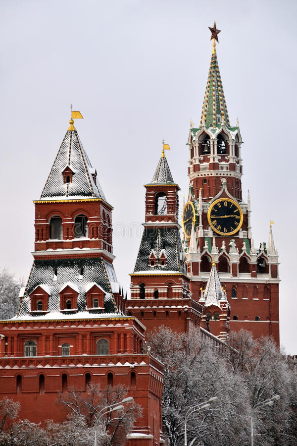 Kremlin Towers Covered Snow - Moscow Kremlin. MOSCOW, RUSSIA - View from Bolshoi Moskvoretsky Bridge on the Savior Tower Spasskaya Bashnya and few over towers of stock image