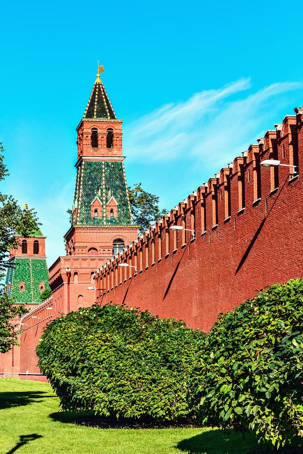 Kremlin wall tower`s. After trees at summer sunny morning on the sky background stock photography